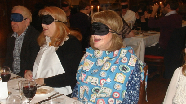 Four people blindfolded at previous Dining in the Dark event