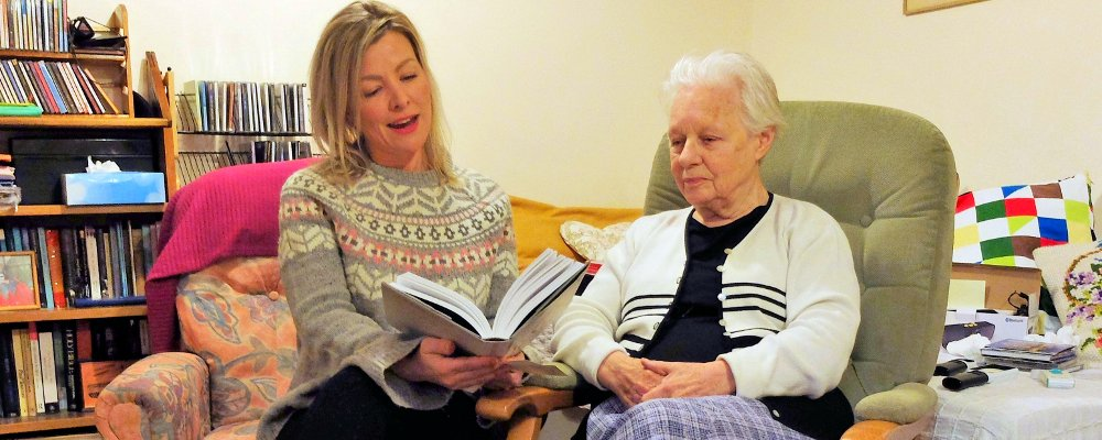 Volunteer reading to client