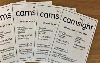 Four pages of the printed black and white front pages of the Cam Sight Winter Newsletter